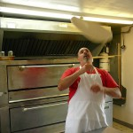 Brian D'Millo throwing dough